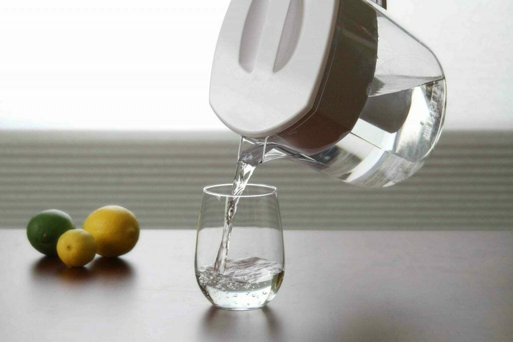 pouring filtered water into the glass